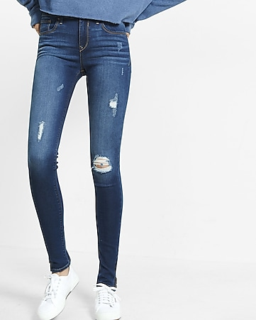 distressed mid rise jean legging