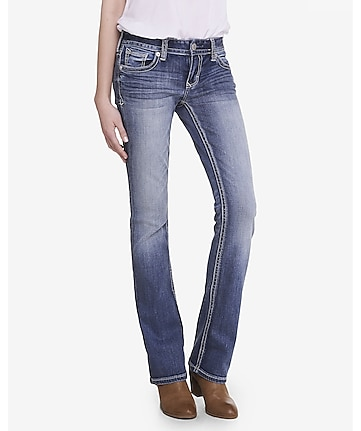 medium wash low rise thick stitch barely boot jean