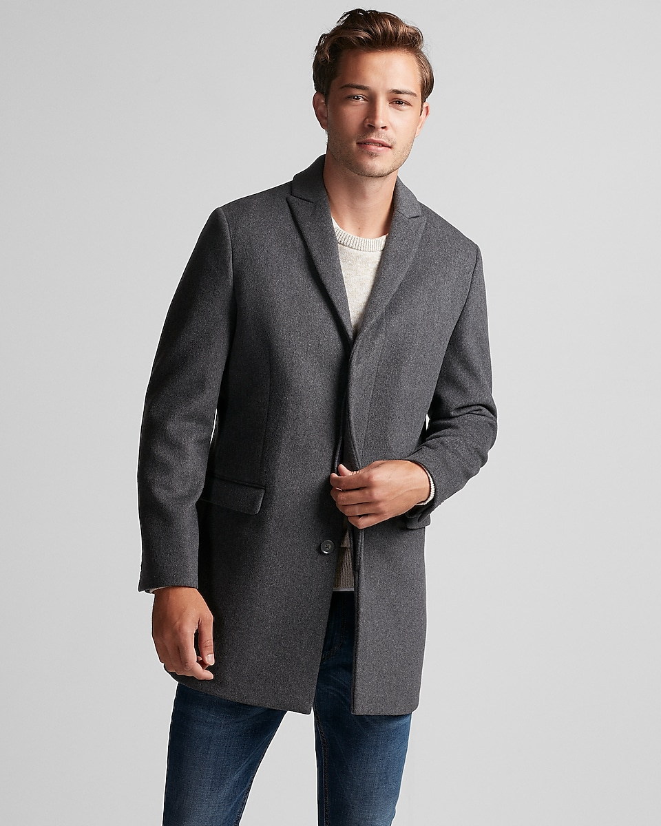 Watch video· This men's coat features nine zippered pockets along with an internal chest pocket. It's got an elastic waist cord, adjustable wrist cuffs and a removable insulated hood.