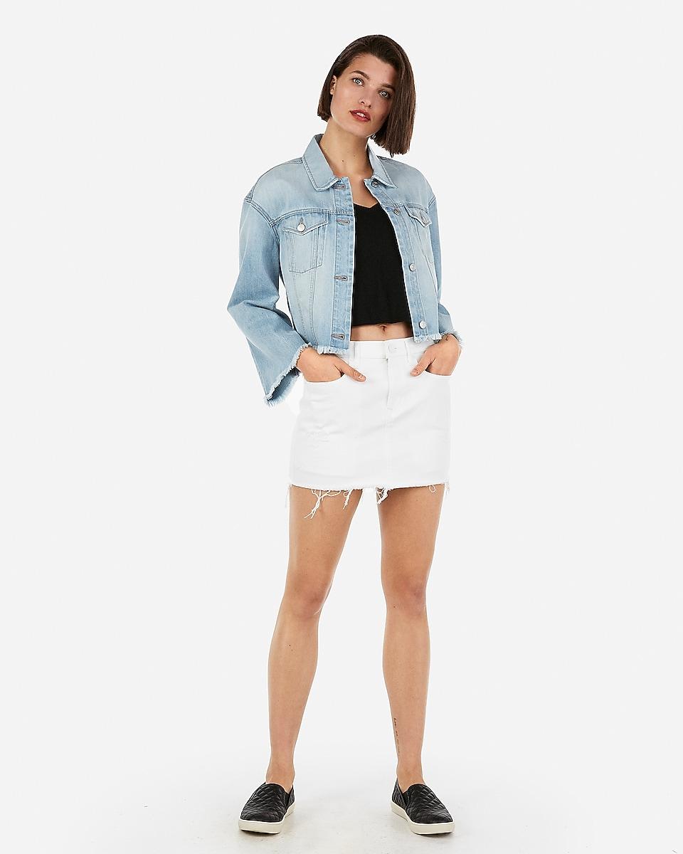 Petite mid rise distressed white mini jean skirt