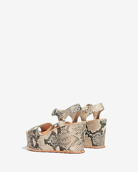 ebe31a60ff8 Dolce Vita Snake Datiah Wedge Sandals