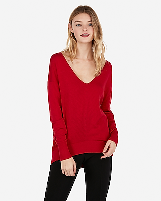 petite solid slouch back tunic sweater